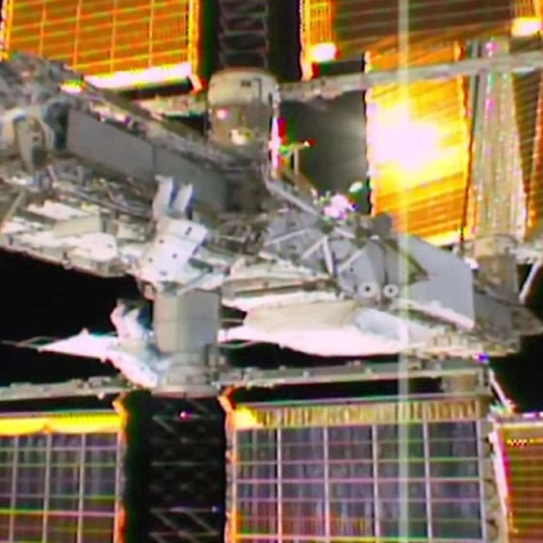 Spacewalkers carry out space station power system upgrades